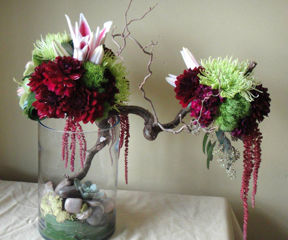 Dahlias, spider mums, dianthus, stargazers, branches and cymbidium orchids arrangement