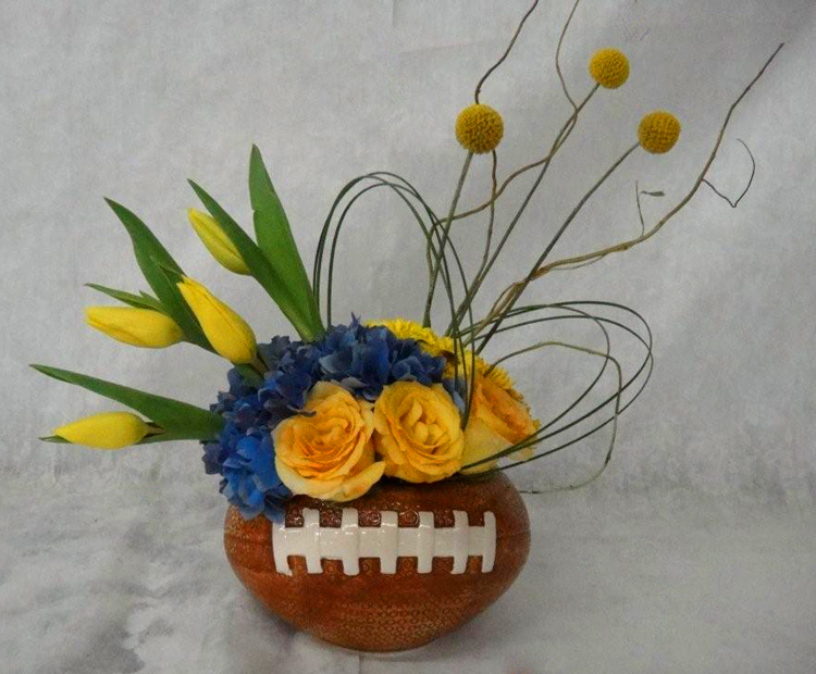 Ceramic Football Vase filled with Roses, Hydrangea, Tulips, Curly Willow and Billy Balls